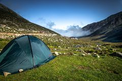 Black tent on the top of the Kackar Mountains  in Rize,Turkey. Black tent on the top of the Kackar Mountains.A popular place for hiking and camping every season Royalty Free Stock Photo