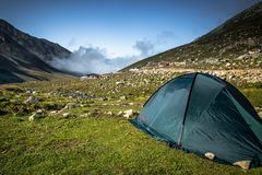 Black tent on the top of the Kackar Mountains in Rize,Turkey. Black tent on the top of the Kackar Mountains.A popular place for hiking and camping every season stock images
