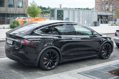 Black tesla car parked in the street near train station Royalty Free Stock Images