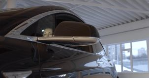 Black Tesla electric car model X in the promotion showroom. stock video footage