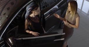 Black Tesla electric car model X in the promotion showroom. stock video