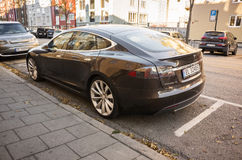 Black Tesla model S, full-size all-electric car Stock Photography