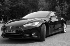 Black Tesla Motors Model S - Front view black white Stock Photo