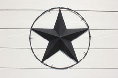 Black Texas Star. Encircled in barbed wire Stock Image