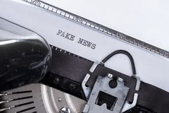Black text Fake News written on an old typewriter royalty free stock photography
