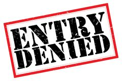 Entry denied. Black text graphics entry denied in grunge block letters inside red rectangle on white Stock Photo
