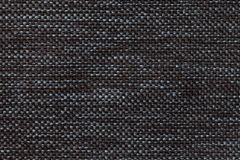 Black textile background with checkered pattern, closeup. Structure of the fabric macro. Stock Images