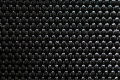 Black textile texture. Seamless black textile texture with checkered patterns Royalty Free Stock Image