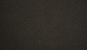 Black textile texture. Black rough textile texture can be used as background Royalty Free Stock Image