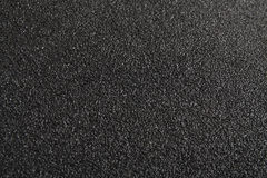Black texture. Black asphalt or sand paper texture stock image
