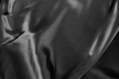 Black Texture, Dark Wavy Glossy Silk Drapery. As background Stock Image