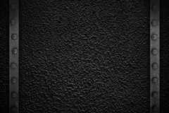 Black texture with metal frame. And rivets Stock Photography