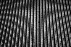 Black texture plastic with wave. Closeup Useful as background for design-works Stock Photos
