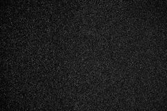 Black textured background - Sandpaper texture for Backdrop. Abst. Ract rough sandpaper sheet close up for banner, poster, ad, template, design Royalty Free Stock Image