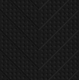 Black textured plastic chevron in small holes Stock Photography