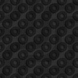 Black textured plastic diagonal donuts with waves Royalty Free Stock Images