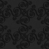 Black textured plastic diagonal spiral flourish Royalty Free Stock Photo