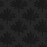 Black textured plastic maple leaves countered with inside Royalty Free Stock Photos