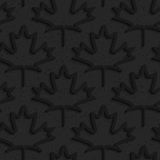Black textured plastic maple leaves countered Royalty Free Stock Image