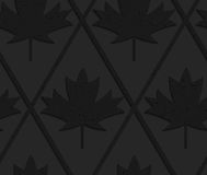 Black textured plastic solid maple leaves Royalty Free Stock Photography
