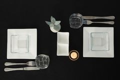 Black theme table setting. Overhead view of black theme table setting stock photography