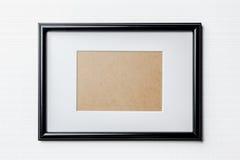 Black thin frame on white bricks background Stock Photos