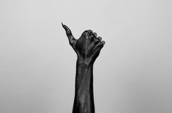 Black thin hand of death Stock Images