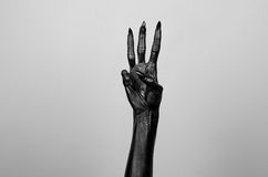 Black thin hand of death. Perfomance photography session witj new characters Royalty Free Stock Photos