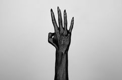 Black thin hand of death. Perfomance photography session witj new characters Stock Image