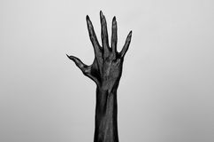 Black thin hand of death. Perfomance photography session witj new characters Stock Images