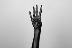 Black thin hand of death. Perfomance photography session witj new characters Royalty Free Stock Photo