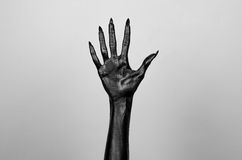 Black thin hand of death. Perfomance photography session witj new characters Royalty Free Stock Images