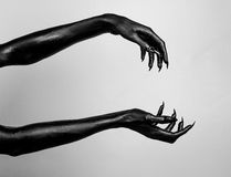 Black thin hands of death. Perfomance photography session witj new characters Stock Images