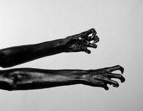 Black thin hands of death. Perfomance photography session witj new characters Stock Photo