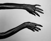 Black thin hands of death. Perfomance photography session witj new characters Stock Photos