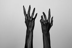 Black thin hands of death. Perfomance photography session witj new characters Royalty Free Stock Photography