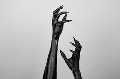 Black thin hands of death. Perfomance photography session witj new characters Stock Photography