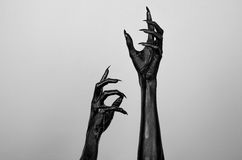 Black thin hands of death. Perfomance photography session witj new characters Royalty Free Stock Image