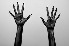 Black thin hands of death. Perfomance photography session witj new characters Stock Image