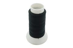 Black thread on few bobbin / spool Stock Image
