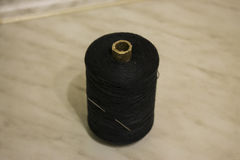 Black thread with a needle Royalty Free Stock Photo
