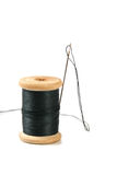 Black thread spool with needle Royalty Free Stock Images