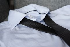 Black Tie on Blue Shirt royalty free stock images