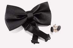 Black tie with cuff links Royalty Free Stock Images