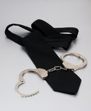 Black tie and handcuffs. Black tie and meatl handcuffs bdsm concept stock images