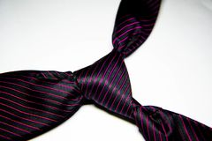 Black tie with purple lines with knot Royalty Free Stock Images