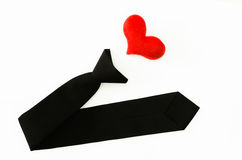 Black tie with red heart on white backgrond, love working, love. My job Royalty Free Stock Image