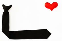 Black tie with red heart on white backgrond, love working, love. My job Stock Photo