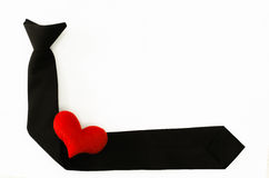 Black tie with red heart on white backgrond, love working, love. My job Royalty Free Stock Photos