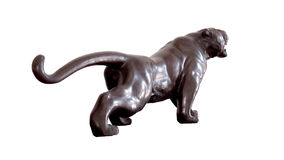 Black tiger. Sculpture represents a tiger, isolated on white depth Stock Photo